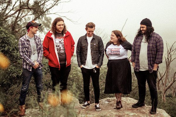 Amends release song featuring Laura Jane Grace